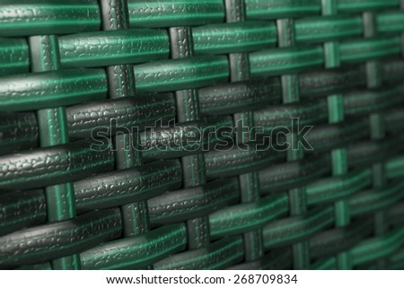 Color synthetic rattan texture weaving background. Closeup of synthetic rattan weave texture as used on outdoor garden furniture . Modern colors. Useful as background or texture - stock photo