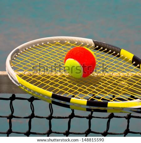 Color tennis ball on racquet - stock photo
