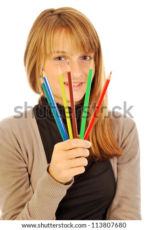 Color the world - 160 - A girl holds in hands of colored pencils - stock photo