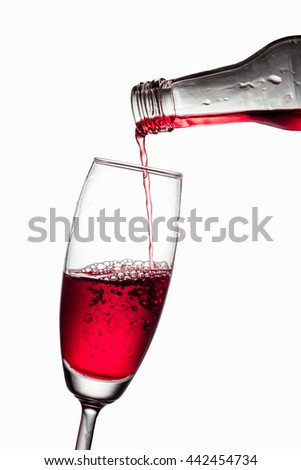 Color water into a glass on white background