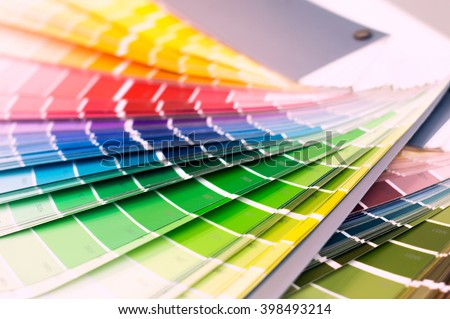 Color wheel for choosing paint tone - stock photo
