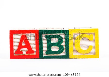 Color wooden alphabet blocks isolated on white