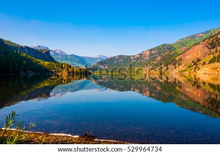 Colorado mirrored reflections in water at San Gabriel lake a Rocky Mountain summer landscape a gorgeous colorful amazing nature escape