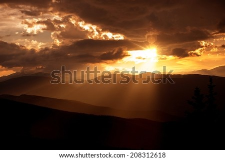 Colorado Mountains Silhouette During Summer Sunset. Mountains Sunset Scenery. - stock photo