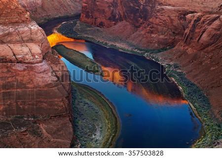 Colorado River at sunrise, Horse Shoe Bend, Page, Arizona, USA - stock photo