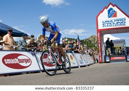 COLORADO SPRINGS, CO - AUG 22: Professional cyclist Daniele Callegarin rides the prologue course of the 2011 USA Pro Cycling Challenge in Colorado Springs, USA on Aug 22, 2011 - stock photo