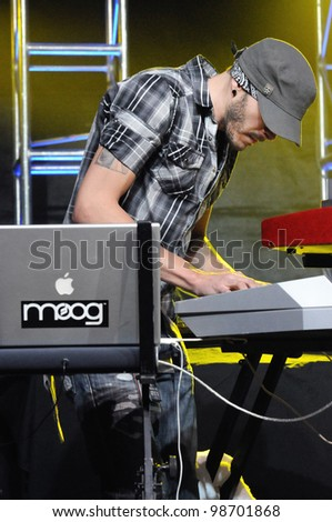COLORADO SPRINGS, CO. USA	MARCH 06:		Keyboardist Chris  Mendoza of the band Everlast performs in concert March 06, 2012 at the City Auditorium in Colorado Springs, CO.