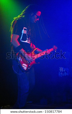COLORADO SPRINGSMARCH 30:Guitarist Doyle Williams of the Alternative Rap band Rehab performs in concert May 30, 2012 at the Black Sheep music hall in Colorado Springs CO. - stock photo