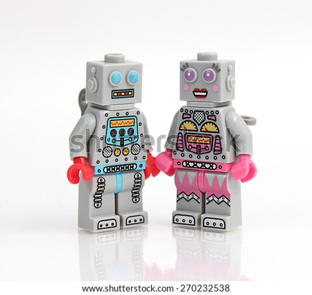 Colorado, USA - April 17, 2015: Studio shot of stack of Lego robots in love. Legos are a popular line of plastic construction toys manufactured by The Lego Group, a company based in Denmark. - stock photo