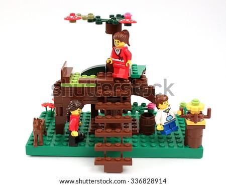 Colorado, USA - November 8, 2015: Studio shot of Lego playground scene with minifigures, kids, and dog. - stock photo