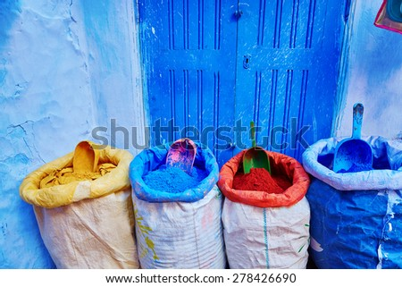 Colorants for sale on a street in Medina of Chefchaouen, Morocco, small town in northwest Morocco known for its blue buildings - stock photo