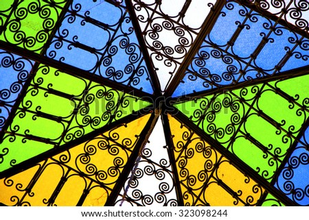 colorated glass and sun in morocco africa window and light - stock photo