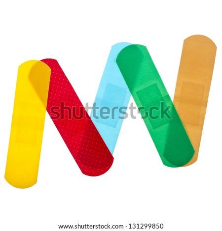 colored adhesive bandage plaster  close up macro , isolated on a white background - stock photo