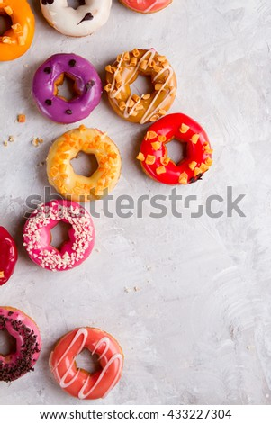 Colored assorted donuts with glaze, selective focus