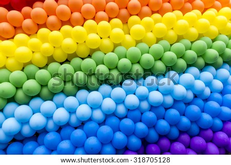 colored balloons in a rainbow after the rain