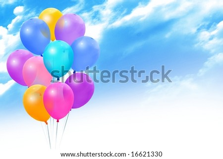 Colored balloons on blue sky - stock photo