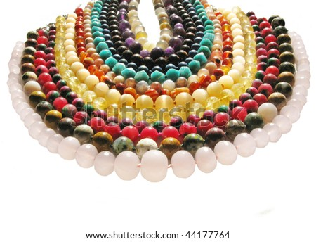 colored beads made of different kinds of natural jewels - stock photo