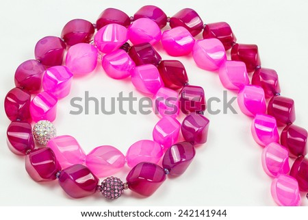 colored beads on a white background