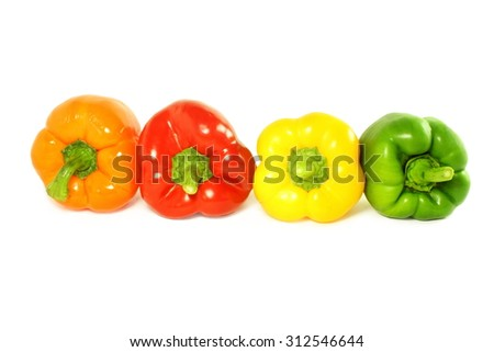 colored bell peppers on white background