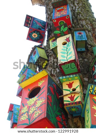 Colored bird boxes with national ornaments in park - stock photo