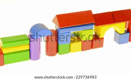 colored building blocks arranged to a wall with gate