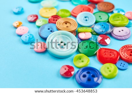 Colored buttons on blue paper background