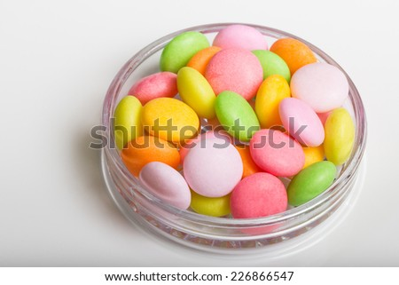 Colored candies on white background