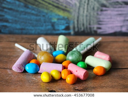 colored candy and chalks in a variety of colors arranged