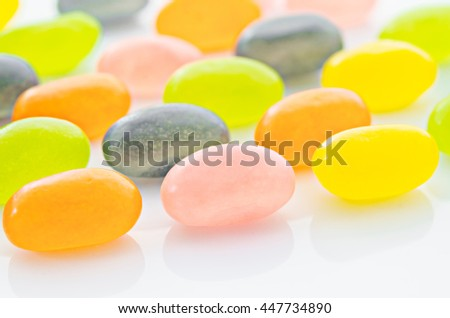 colored candy on white background - stock photo
