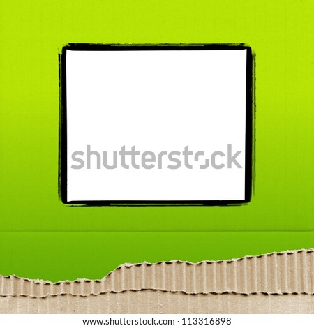 colored cardboard background paper texture with photo frame - green - stock photo