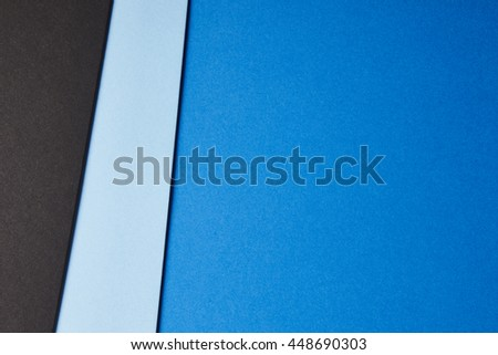 Colored cardboards background in blue black tone. Copy space. Horizontal