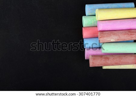colored chalk on a black background