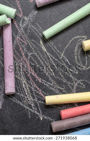 Colored chalk on a blackboard background, from above - stock photo