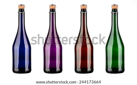 Colored champagne bottles with cork isolated on a white background