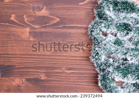 colored Christmas lights on a color textured board left space for text - stock photo