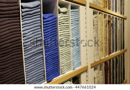 Colored clothes on the shelves