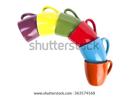 Colored coffee mugs pile isolated on white background - stock photo