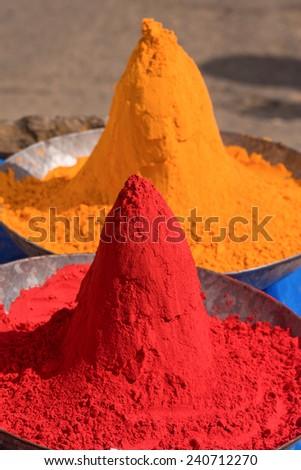Colored colorful powder kumkum on Indian bazaar for holi festival celebration - stock photo