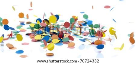 colored confetti falling on white - stock photo