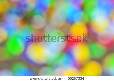 Colored confetti out of focus.