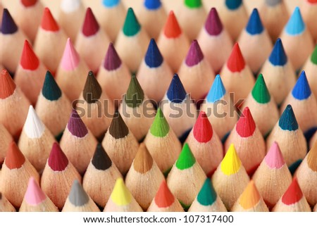 Colored crayons in a row showing their upper part - stock photo
