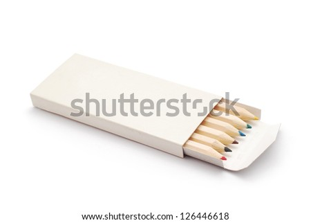 colored crayons in open box - stock photo