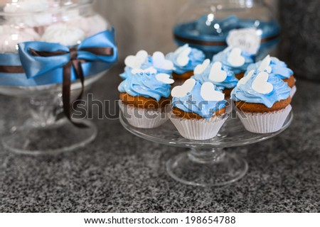 Colored cupcakes. Muffins with cream - stock photo