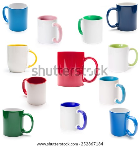 colored cups on a white background izorirovannye - stock photo