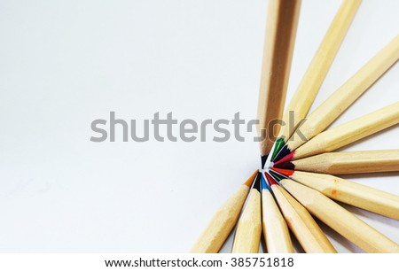 Colored drawing pencils in a variety of colors in white isolated background - stock photo
