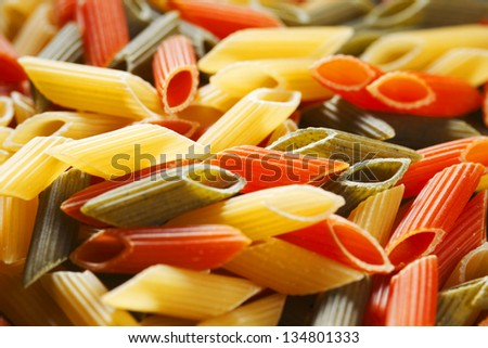 Colored dry italian pasta background