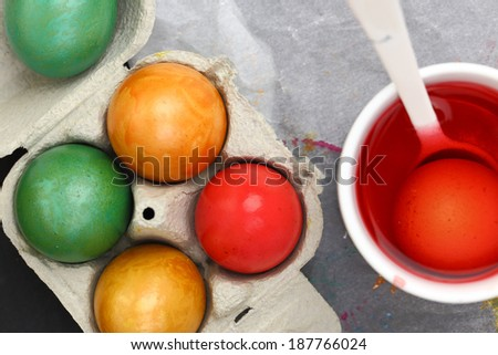 Colored Easter eggs and liquid color dye - stock photo
