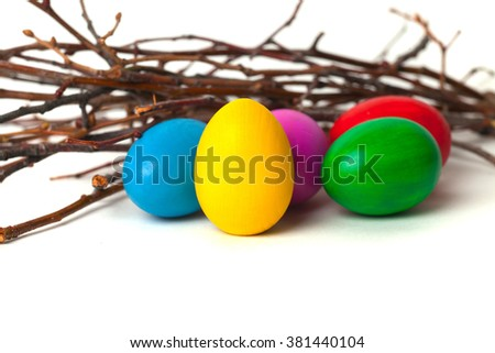 Colored Easter eggs from the branches. On a white background.