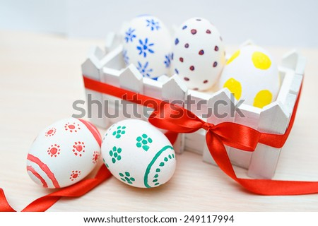 colored easter eggs in the fence. - stock photo