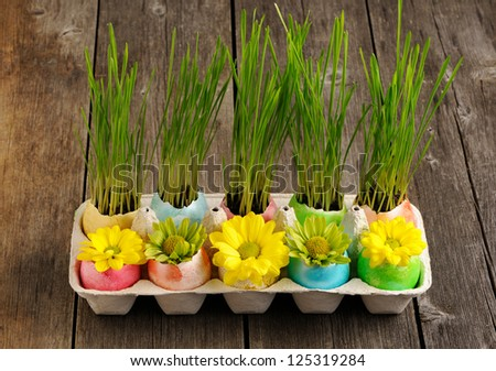 Colored easter eggs on wooden table - stock photo